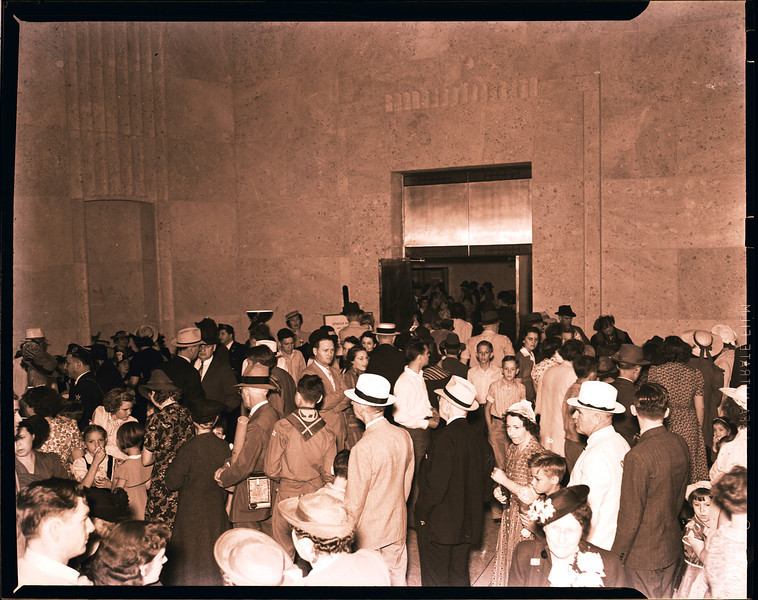 The lobby was full during the two-day opening event.  The doors in the far wall open to what was called the Anglo-American Room at the time of the opening; that is the present exhibit gallery.
