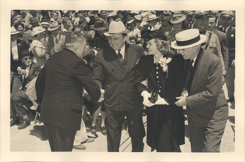 "Many in the crowd came to hear the popular ""Pappy"" O'Daniel during his noon-time address.  Here George A. Hill, Jr. greets Texas Governor W. Lee O'Daniel, his wife Merle O'Daniel, and Oscar Holcombe, mayor of Houston, when they arrived shortly before noon on April 21, 1939."