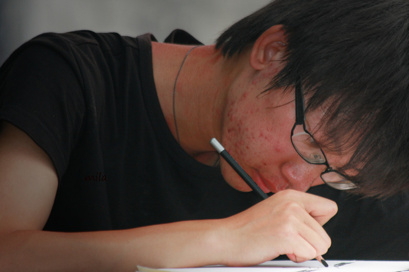 Local boy doing his homework in Wannan (Shanghai)