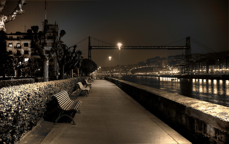 Walking alone by the riverside (Getxo, Bizkaia)