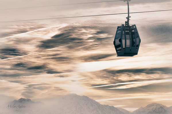 When the ski resort is closed, the gondola lifts enjoy in secret the silent of the sunset :)
