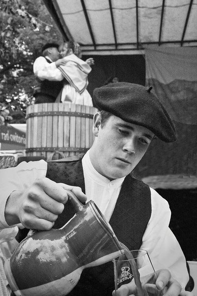 "2010  grape harvest festival in Laguardia (Rioja, Basque Country).  <a href=""http://www.fiestadelavendimia.net/index.html"">http://www.fiestadelavendimia.net/index.html</a><br /> A local boy serves wine while a couple tread grapes.<br /> Laguardia  is a walled villa which name derives from Navarra´s "" La Guarda "" ( The Guardian ) due to the strategic position it holds against Castilla. To this day , Laguardia is a complety pedestrian town because its wine cellars built at light meters deep. Its main activity is viticulture and as a result of the area´s microclimate and deep-rooted wine tradition, the highest quality Rioja Designation of Origin wines are elaborated here"