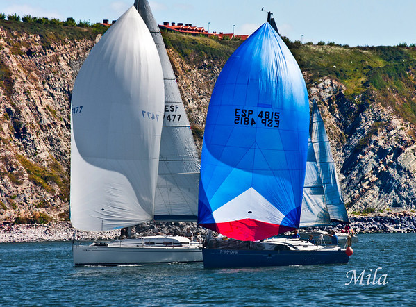 """Sailboats in front of the cliffs of """"La Galea"""" in Getxo  (Biscay, Basque Country)"""