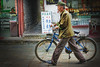 The bike and the mao suit are becoming symbols of the past times in the urban China.