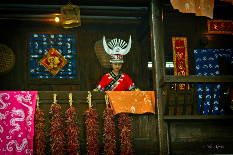 Chinese National Minorities.  Miao Lady. The Miao, with a population of seven mllions,  are one of the most ancient of China's nationalities, tracing their origins back more than 4,000 years.  The Miao language has three main dialects, but there was no unified written script until 1956. Religions include nature and ancestor worship and Christianity.<br /> Forced southward by the Han, often despised and exploited, many settled in distant mountains, raising millet and buckwheat by slash-and-burn farming, their diet supplemented by domestic animals and hunting. Modernization, improved farming methods, organization of communes, and road building has been made difficult by the ragged terrain in which the Miao are scattered. <br /> The Miao are found in the Guizhou, Hainan, Hubei, Sichuan, Gansu, Guizhou, Qinghai, Hunan, Guangdong, and Yunnan Provinces and the Guangxi Autonomous Region.