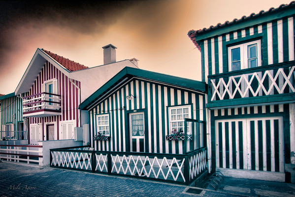 Aveiro's multicolored striped houses, an invitation to enjoy the beach and the ocean in Portugal