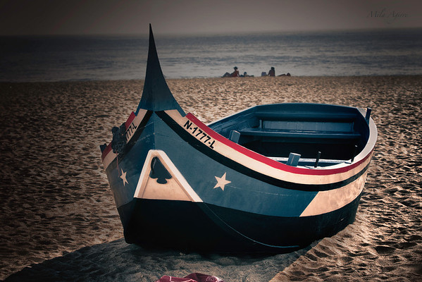 A boat waits for its owner's return to go into the sea...