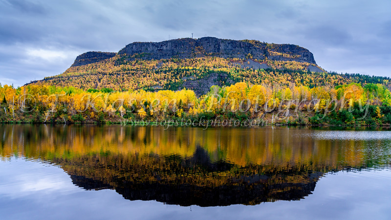 Mount McKay with fall foliage color reflected in the Kaministiquia River near Thunder Bay, Ontario.