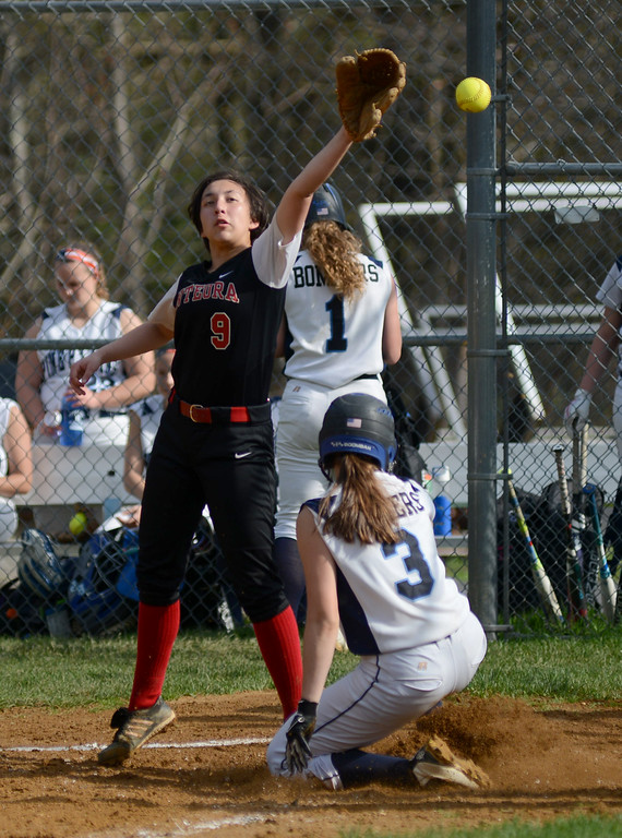 . Tania Barricklo-Daily Freeman    Onteora\'s pitcher Tyler Nguyen covers first but ine Plains\' Jo Schmidt gets there safely