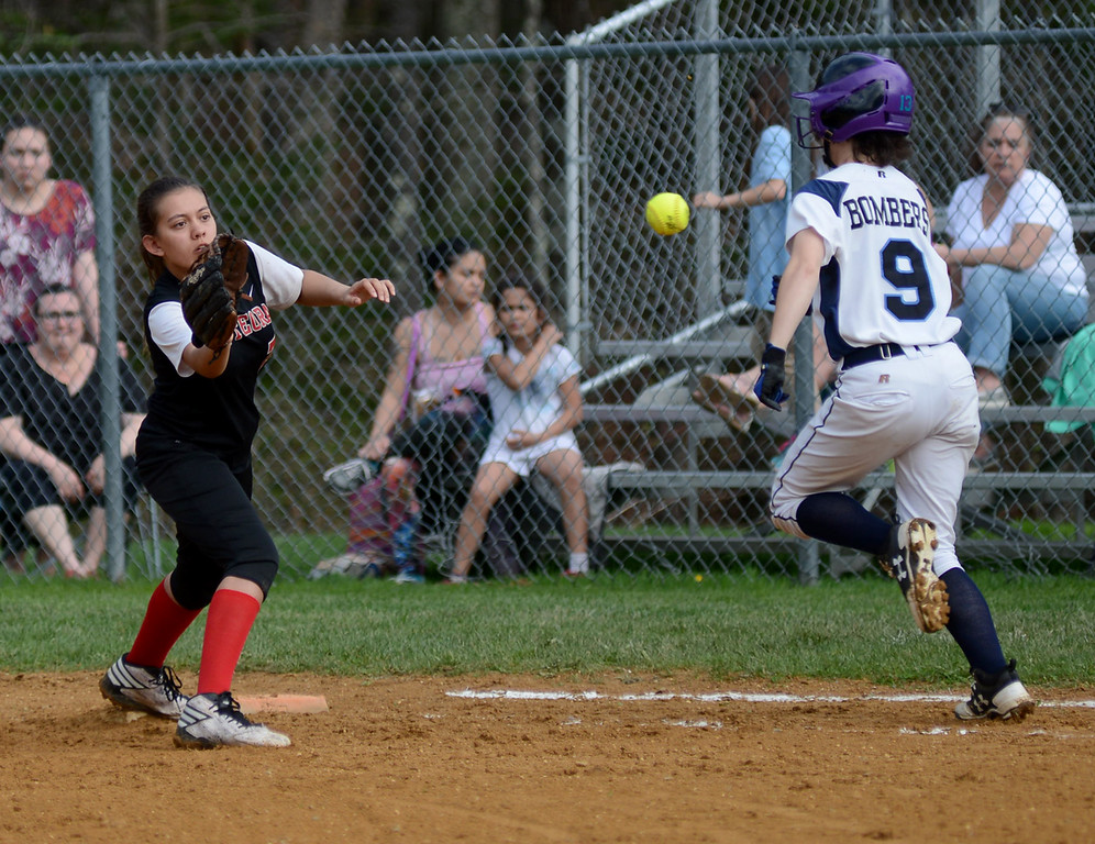 . Tania Barricklo-Daily Freeman First baseman Mia Quick waits to make the catch , but Pine Plains Kris Wilson makes it safely.