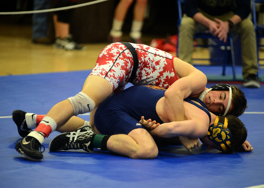 . Tania Barricklo-Daily Freeman                      Tania Barricklo-Daily Freeman Zach Chartrand with Highland\'s Johnny Decalir 145 lbs.