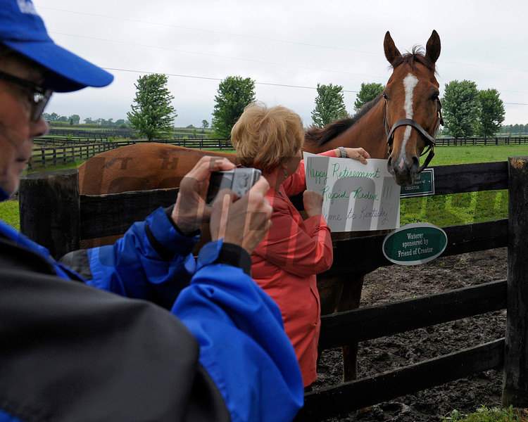 Caption:  fan with sign has her photo taken<br /> Rapid Redux after his recent arrival at Old Friends near Georgetown, Ky. on June 1, 2012.<br /> RapidRedux image382<br /> PHoto by Anne M. Eberhardt