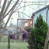 """This video provided by the Palestine Fire Department shows a propane tank on """"venting"""" on the back porch at the scene of the house fire on East Dallas Street in Palestine."""