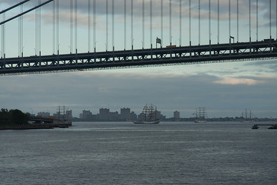 Tall Ships at anchor in Lower New York Bay beyond the Verrazano Narrows Bridge.