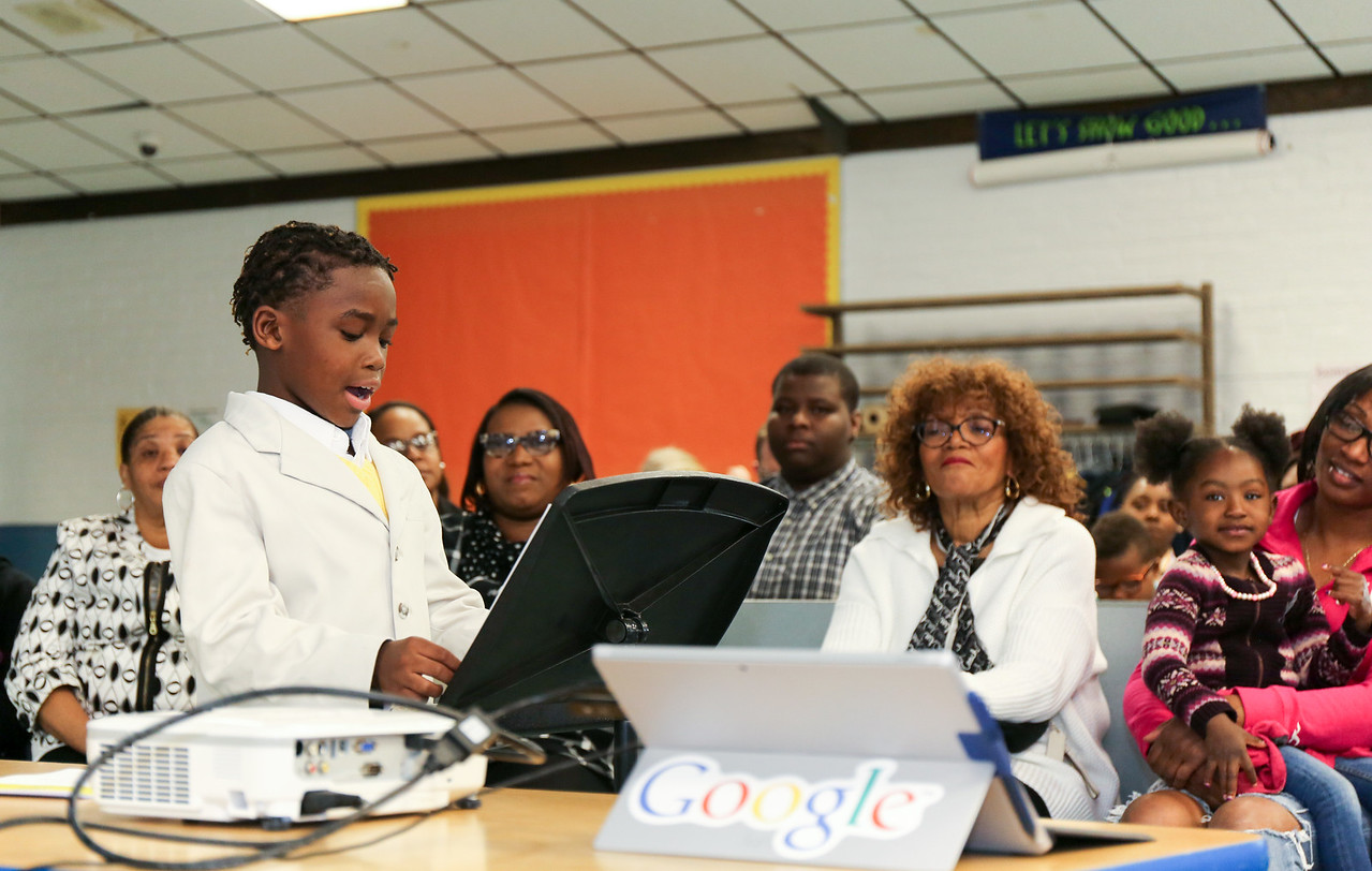 Second grader Isaiah Tripp speaks to the Board of Education. <br /> Photo by John Fitts