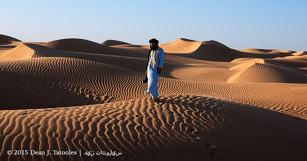 Photo Credits: Dean J. Tatooles; Southern Cross Galleries | This is one of my favorite images from my recent trip to Morocco.  Here, my dear friend Said Ahnana stands powerfully at sunset within the sweeping sand dunes of the Sahara Desert near Erg Chebbi.