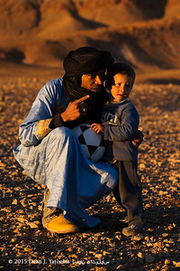Photo Credits: Dean J. Tatooles; Southern Cross Galleries  | What a precious moment. Late one afternoon, we visited a nomadic home and enjoyed tea with the family at sunset in the  Sahara. As the light became golden and just before the sun set, I captured this image of one of our guides and dear friend, Said Ahnana of #‎opendoorsmorocco giving this child a brand new soccer ball as a gift. Soccer (or Futbol) is widely played by the desert people in the sand in bare feet. This was a special treat for this little guy.