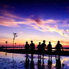 A group of kids enjoy themselves on the tidal flats at low tide after sunset at Rock Harbor, Orleans, Cape Cod, Massachusetts