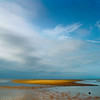 The sun shines down on part of the tidal flats at Robbins Hill Beach in Brewster on Cape Cod, Massachusetts.