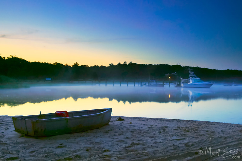 A mist rises from the water before sunrise at the town landing at West Bay in Osterville on Cape Cod, Massachusetts.