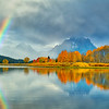 A rainbow forms above the Snake River at Oxbow Bend and Mt Moran above the Snake River at Grand Teton National Park in Wyoming during fall foliage.