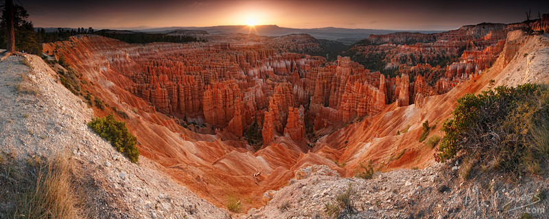 The sun rises at Bryce Canyon National Park in Utah in May.<br /> <br /> I had done some scouting the evening before, hiking along the rim looking for good<br /> viewpoints. I found this location that evening, made a note of the spot, and went <br /> back to my tent for the night. I hiked back to the same location in the dark the <br /> following morning to be ready for the sunrise and waited for the light.<br /> <br /> A total of 7 photographs were stitched together to give me this nearly 180 degree<br /> view. With the countless hoodoos in this scene one can understand just how <br /> difficult it was to make sure all 7 of those photos combined together perfectly.<br /> Many, many hours in my digital darkroom were consumed making sure it was <br /> just perfect.
