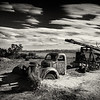 It was really cool to come across this old work truck - complete with tons of bullet holes - slowly sinking in the dirt out in the middle of nowhere at Capitol Reef National Park in Utah.<br /> <br /> Because of the grittiness of the scene, I thought it would be good to give this a film noir look to it - hence the grain in the image.
