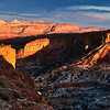 To get to this spot for sunset at Capitol Reef National Park, Utah, we hiked about 1.5 miles. <br /> <br /> One area in particular involved a little bit of scrambling down some large boulders then walking along loose rock with a nice drop-off to the right.<br /> <br /> But once we were there this location yielded many great shots such as this one.