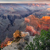 I spent almost a week photographing the South Rim of the Grand Canyon on this particular trip. This multi-photo stitched panoramic was photographed at sunset at Powell Point, west of the Village area.<br /> <br /> I ended up getting to this location around noon, found a great spot, and waited there out in the sun and summer heat for the sunset to arrive.<br /> <br /> When sunset did arrive it wasn't as dramatic as many of the sunsets I photograph, and that is why I love this particular photo. It features a soft pastel color profile that creates a wonderful mood in any home or office.