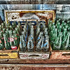 """""""Empty Bottles"""" - New Mexico - This was photographed in Northern New Mexico in an old fountain drink type of trailer. The glass bottles feature Dr Pepper, Sunkist, and Coca Cola with a rusty old Pepsi sign in the background."""