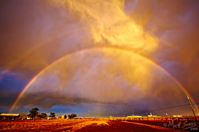 A double rainbow lights up the sky just South of Santa Fe, New Mexico as a storm passes by at sunset.