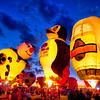A penguin and beer hot air balloons on glow night at the Albuquerque Balloon Festival in New Mexico.