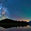 The Milky Way and stars reflect in the Snake River at Oxbow Bend above Mt Moran in Grand Teton National Park, Wyoming