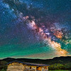 The Milky Way and stars above Cunningham Cabin in Grand Teton National Park in Wyoming.