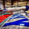 Airplane hanger with old planes at Santa Fe Airport in New Mexico. This is a Navy AT-6 SNJ Texan plane.