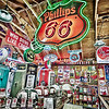 """""""Phillips 66"""" was photographed in Northern New Mexico. The interior of this building had a lot of old gas station pumps, license plates, neon lights, and other car themed antiques."""