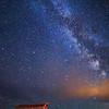 Milky Way and night stars during summer at Grand Teton National Park in Wyoming at the John Moulton Barn.