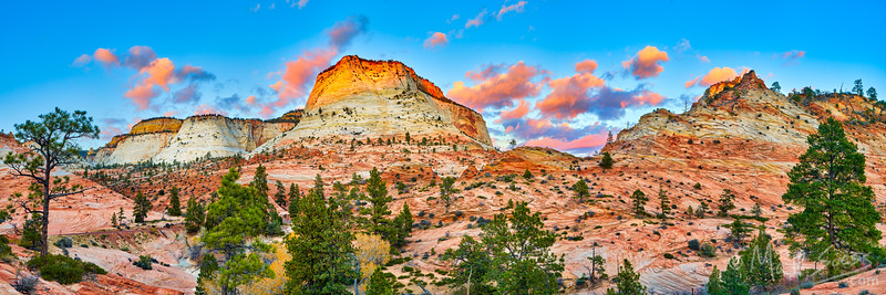 The unique sandstone rock formations of the East side of Zion National Park in Utah are on full display in this panoramic shot photographed at sunset.