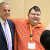 The Arc of Opportunity of North Central Massachusetts staff and representatives from Comcast NBCUniversal hosted an Open House from that launched The Arc of Opportunity's Coaching Center, which is offering individualized consultations designed to help individuals with intellectual and developmental disabilities use technology to achieve greater independence on Tuesday afternoon, October 2, 2018. Mickey Dower a participant in the program poses with Leominster Mayor Dean Mazzarella after talking talks about how the technology saved his life. SENTINEL & ENTERPRISE/JOHN LOVE