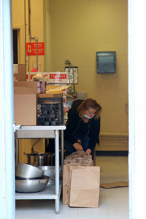 Packing up Meals on Wheels for Seniors