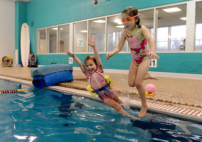 Tania Barricklo-Daily Freeman                      Three year old Hallie Robie, left, daughter of Tasha Clemmer and Travis Robie of High Fals jumps off the end of the pool with five year old Zoe Dodd, daughter of Eric Dodd and Emily Flynn of Kingston. The  two were enjoying the Open Swim at the YMCA in Kingston Wednesday afternoon in Kingston, N.Y.