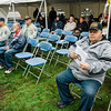 """Veterans listen in during the ceremonies at """"The Wall That Heals"""" at Carter Park on Thursday morning. The wall, a 250-foot replica of the Vietnam Wall, is on display at Carter Park and ceremonies will be held daily through Saturday evening. SENTINEL & ENTERPRISE / Ashley Green"""