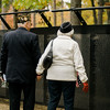 "John Joseph, US Air Force veteran who fought in the Korean War, and wife Joan walk the length of ""The Wall That Heals"" at Carter Park on Thursday morning. The wall, a 250-foot replica of the Vietnam Wall, is on display at Carter Park and ceremonies will be held daily through Saturday evening. SENTINEL & ENTERPRISE / Ashley Green"