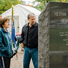 "US Army veteran Peter Krawchuk and wife Marie view the memorials near ""The Wall That Heals"" at Carter Park on Thursday morning. The wall, a 250-foot replica of the Vietnam Wall, is on display at Carter Park and ceremonies will be held daily through Saturday evening. SENTINEL & ENTERPRISE / Ashley Green"