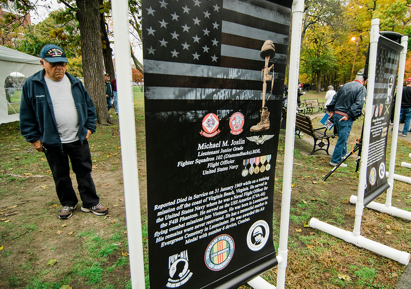 "P. David Dunn, US Army veteran, reads the signage during the ceremonies at ""The Wall That Heals"" at Carter Park on Thursday morning. The wall, a 250-foot replica of the Vietnam Wall, is on display at Carter Park and ceremonies will be held daily through Saturday evening. SENTINEL & ENTERPRISE / Ashley Green"