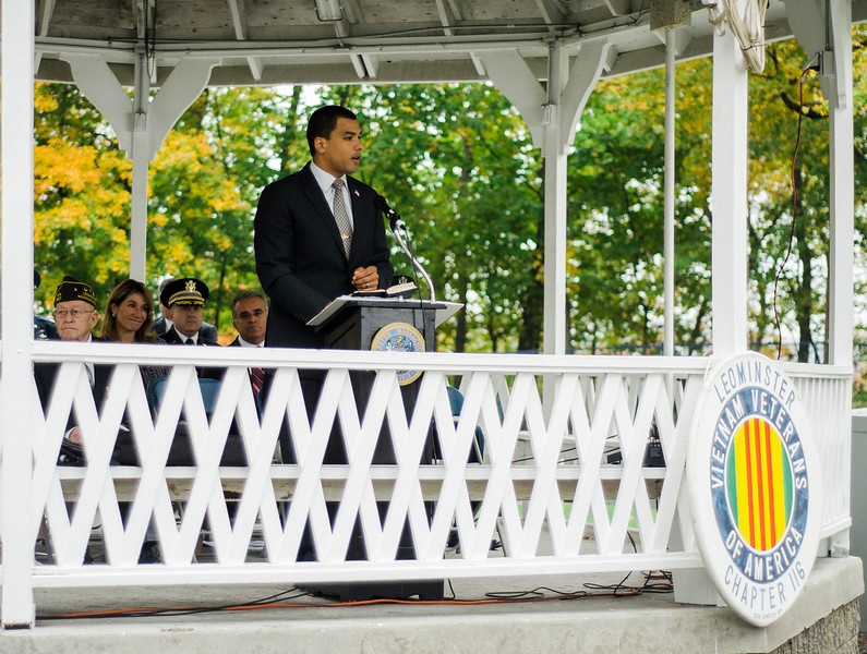 "MA Department of Veterans Secretary Francisco Urena speaks during the ceremonies at ""The Wall That Heals"" at Carter Park on Thursday morning. The wall, a 250-foot replica of the Vietnam Wall, is on display at Carter Park and ceremonies will be held daily through Saturday evening. SENTINEL & ENTERPRISE / Ashley Green"