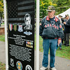 "US Air Force veteran Joe DeMago reads the signage during the ceremonies at ""The Wall That Heals"" at Carter Park on Thursday morning. The wall, a 250-foot replica of the Vietnam Wall, is on display at Carter Park and ceremonies will be held daily through Saturday evening. SENTINEL & ENTERPRISE / Ashley Green"