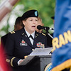 "Captain Michelle Durkee, US Army National Guard Chaplain, gives the Invocation during the ceremonies at Carter Park on Thursday morning. ""The Wall That Heals"", a 250-foot replica of the Vietnam Wall, is on display at Carter Park and ceremonies will be held daily through Saturday evening. SENTINEL & ENTERPRISE / Ashley Green"