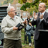"Congressman James McGovern presents overdue Vietnam War medals to Andre LeBlanc during the ceremonies at ""The Wall That Heals"" at Carter Park on Thursday morning. The wall, a 250-foot replica of the Vietnam Wall, is on display at Carter Park and ceremonies will be held daily through Saturday evening. SENTINEL & ENTERPRISE / Ashley Green"
