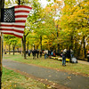 """Spectators observe """"The Wall That Heals"""" at Carter Park on Thursday morning. The wall, a 250-foot replica of the Vietnam Wall, is on display at Carter Park and ceremonies will be held daily through Saturday evening. SENTINEL & ENTERPRISE / Ashley Green"""